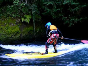 stand up paddle lessons Phuket with a whitewater board